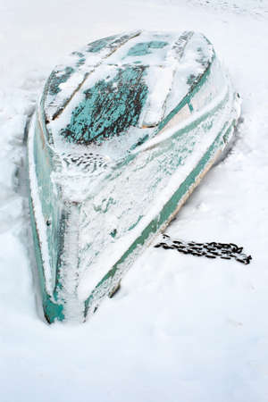 upturned: upturned boat on the snow Stock Photo