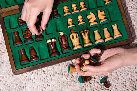 putting the chess pieces in box photo