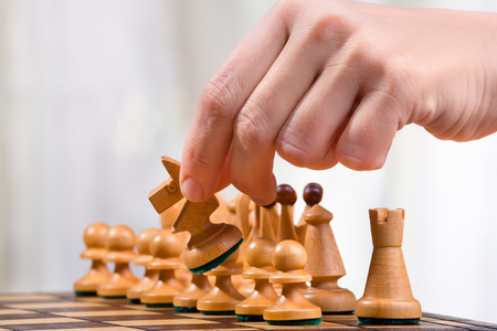 chess player: hand of chess player with knight Stock Photo
