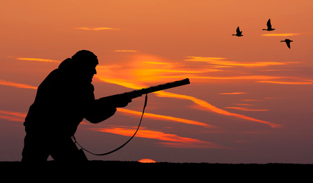 Silhouette of men on the hunting photo
