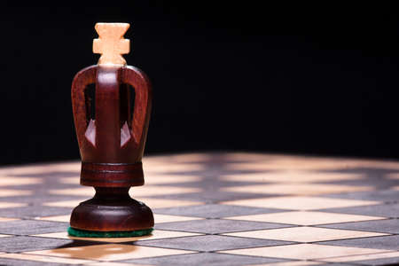 Chess King on the wooden board photo