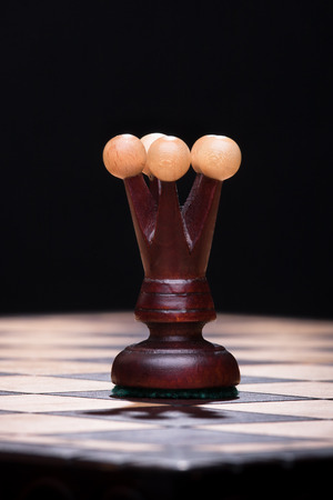 Chess queen on the wooden board photo