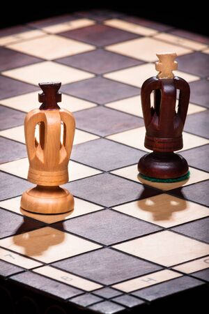 concurrence: two chess king on the wooden board