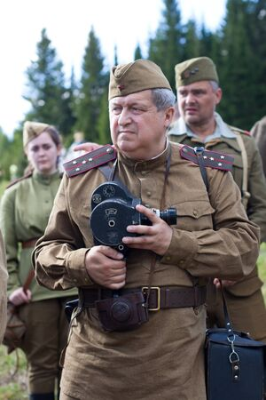 world war 1: Khohlovka, Russia - 1 August, 2015. Event Great maneuvers at Khohlovka hills.  Soviet soldiers of the second world war with movie camera.