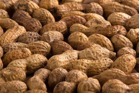 earthnut: heap of unshelled peanuts as background, closeup Stock Photo