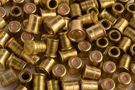 reloading: scattered copper hunting shotgun primers, close up Stock Photo