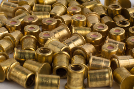 scattered: scattered copper hunting shotgun primers, close up Stock Photo