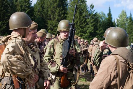 historic world event: Khohlovka, Russia - 1 August, 2015. Event Great maneuvers at Khohlovka hills.  Group of Soviet soldiers of the second world war.