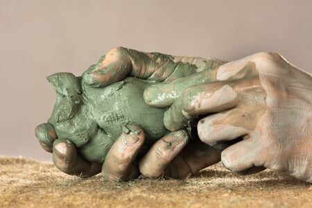moulding: hands of ceramist moulding from blue clay  Stock Photo