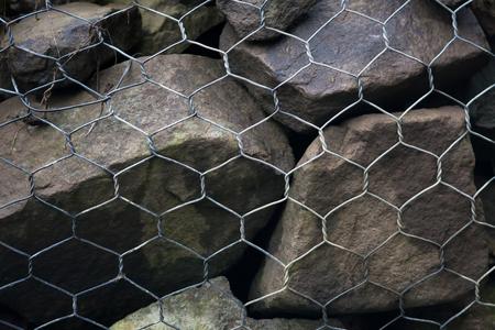 gabion mesh: gabion wall made of stone and steel mesh