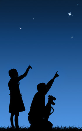 father and his daughter study the starry sky through a binoculars on the lawn Foto de archivo