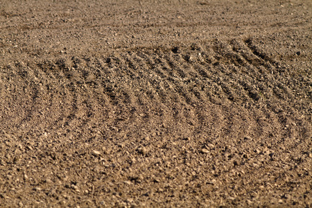 the pattern of furrows on a plowed field (selective focus)