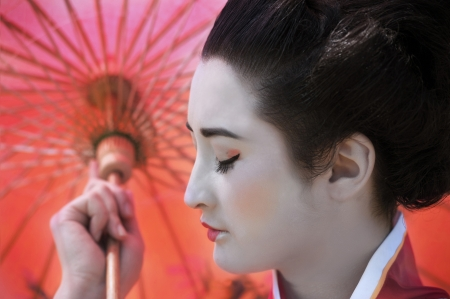 Geisha with red umbrella photo