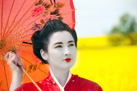 japanese culture: Geisha in the yellow field Stock Photo