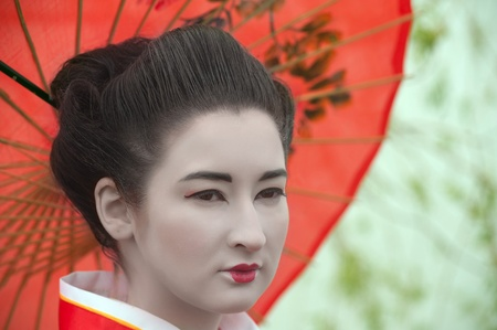Geisha with red umbrella photo