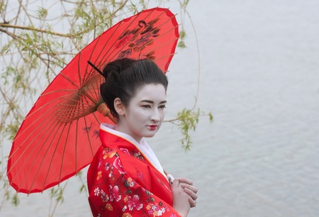 japanese kimono: Geisha with red umbrella Stock Photo