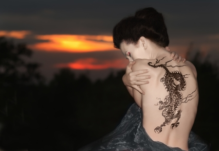 Geisha with dragon tattoo Stock Photo