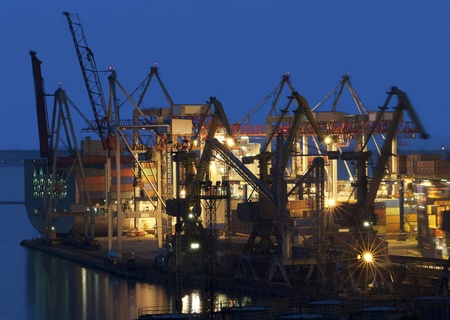 cranes at the container port terminal in sunset time