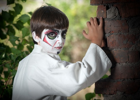 The boy with a samurai makeup photo