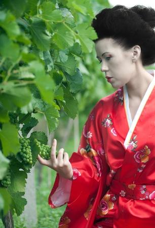 Geisha with dragon tattoo photo