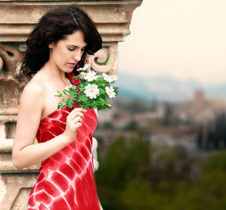 spanish style: Spanish style portrait of woman in red dress with flowers