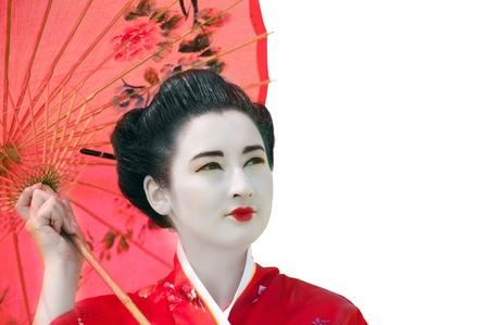 Geisha with umbrella looking up  isolated  Stock Photo