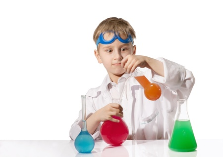 natural sciences: Funny boy in white overall with multicolored chemical flasks