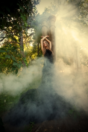 fantasy woman: Mystic portrait of young woman in the forest ruins