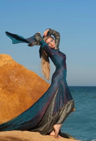 Fantasy style portrait of woman in blue dress