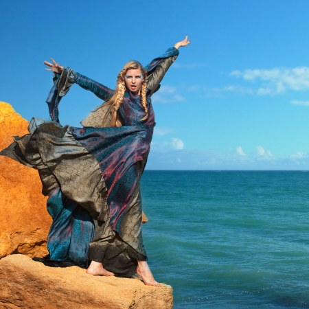 Fantasy style portrait of woman in blue dress at the seashore Stock Photo - 15007730