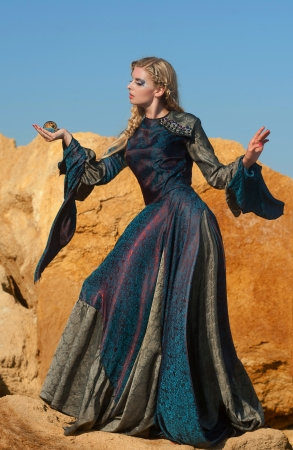 Sorceress with magic sphere Stock Photo - 15007953