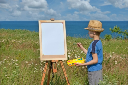 Young artist and blank sheet, outdoor photo