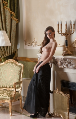 Half nude young woman in luxury interior
