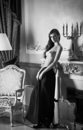 a half nude young woman in luxury interior  black and white