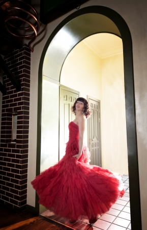 Woman in red evening dress at the door Stock Photo - 15276008