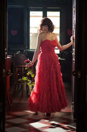 Woman in red evening dress with the rose  full length portrait  Stock Photo - 15275990