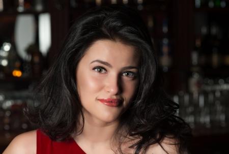 Portrait of smiling brunette girl at a Bar Stock Photo - 15684107
