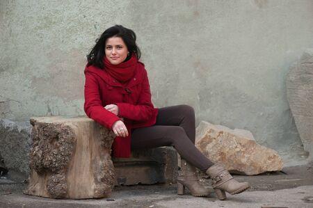 Smiling girl in red coat photo