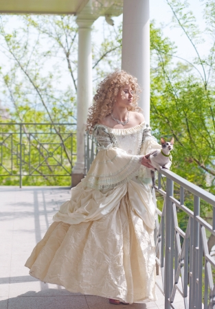 Princess with cat on the terrace  half-length portrait Stock Photo - 15739726