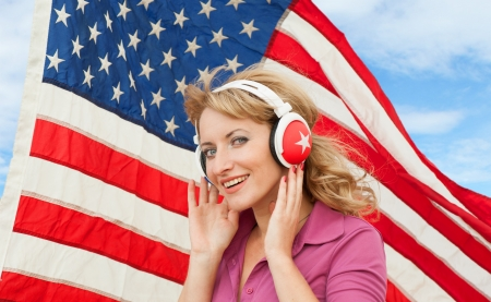 Learning language � American English  blond young woman with headphones  photo