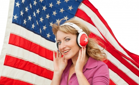 Learning language – American English  blond young woman with headphones, isolated  Stock Photo