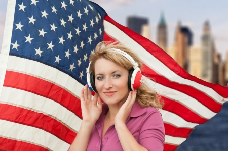 Learning language � American English  blond woman with headphones, city background  photo