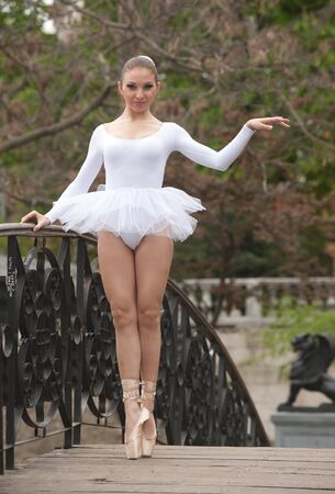Ballerina standing on the bridge photo