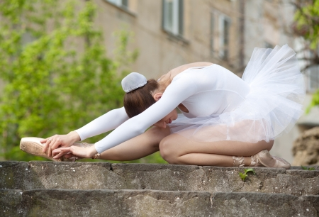 Ballerina training herself, outdoor