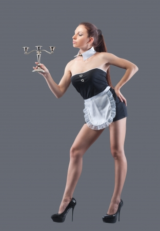 Woman in french maid costume, isolated on grey photo