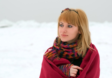 checkered scarf: Portrait of the red-haired girl in red, snow background