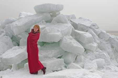 checkered scarf: Woman in red cape in front of the blocks of ice