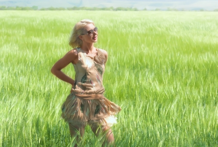 Pretty blond woman in wheat field photo