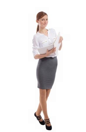 白い背景の上の彼女の手でノートブックを開くとかなり笑顔の女性 写真素材 - 16546536