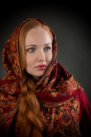 slavic: Portrait of pretty Slavonic girl with red braided hair, looking away, dark background